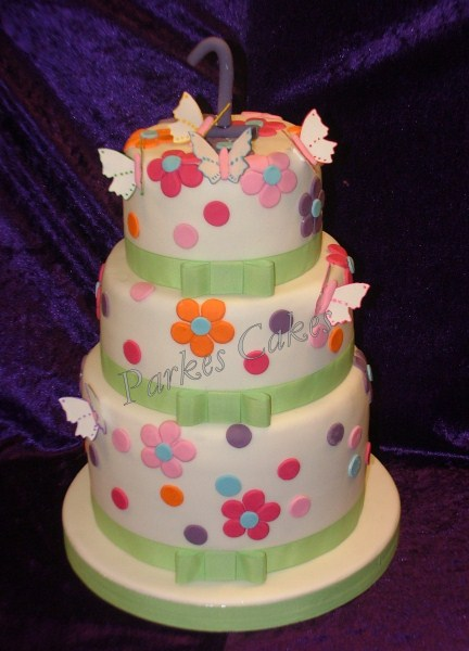 three tier blossoms and butterflies birthday cake