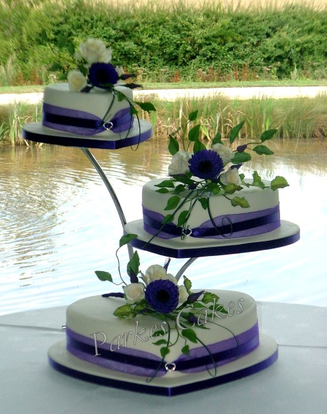 Three Tier Heart Wedding Cake with Roses, Purple Gerberras and Lisianthus Buds