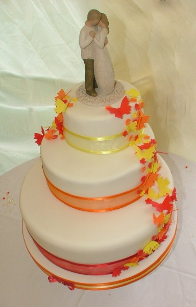 three tier wedding cake with cascading summer butterflies