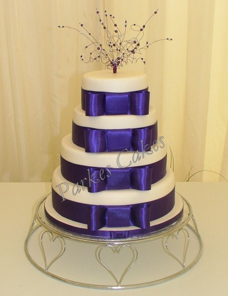 4 tier cadbury purple wedding cake