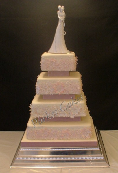 four tier wedding cake with dusky pink flowers