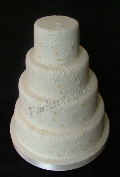 four tier ivory lace wedding cake